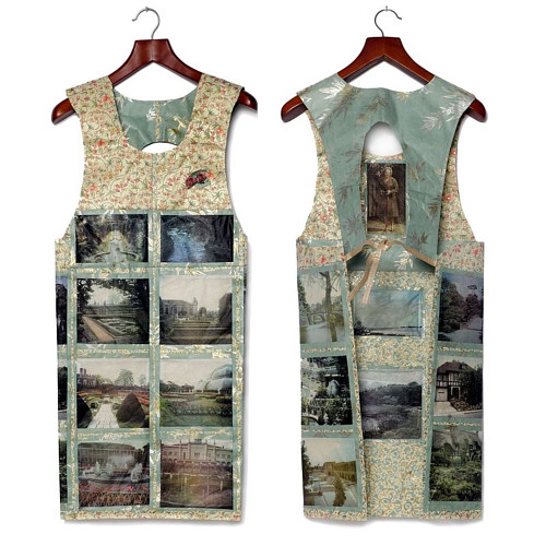 An apron-like garment made from assorted prints and paper