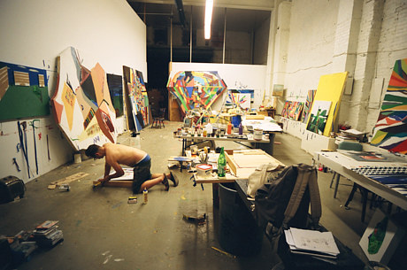 A photo of Chris Johanson at work in his studio