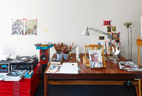 A close-up photo of Elizabeth Peyton's desk in her studio