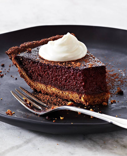 A photograph of a styled slice of chocolate pie