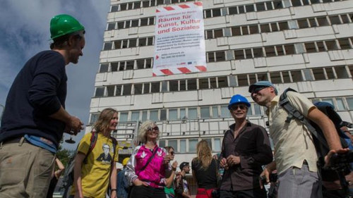A photo of German artist's-rights group AbBa protesting outside an abandoned building