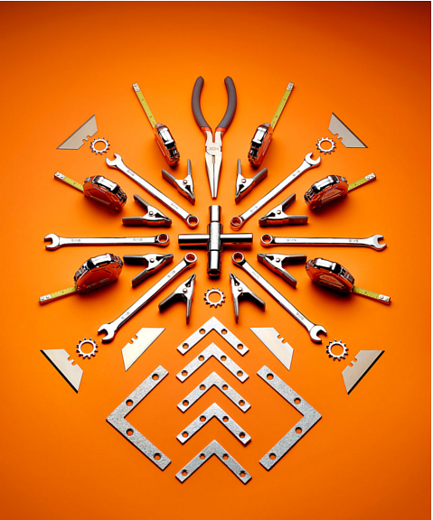 A photo of a pattern of tools on an orange background