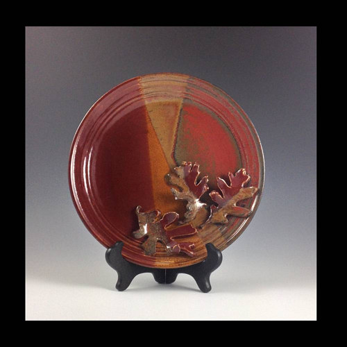 A red and orange colored ceramic plate