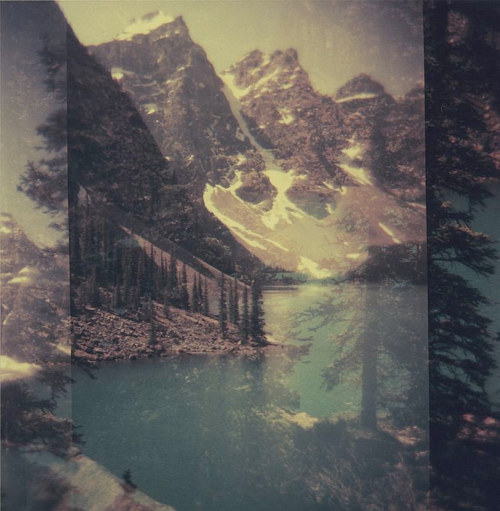 A manipulated photo of a cold lake surrounded by snowy mountains