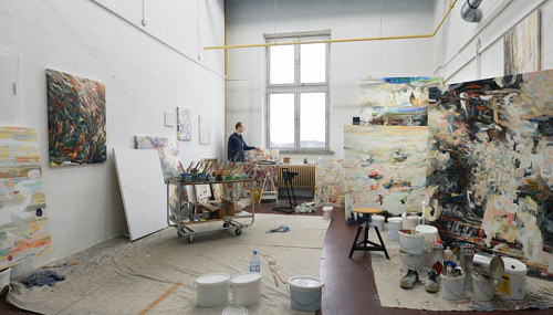 A photo of Uwe Kowski working alone in his painting studio