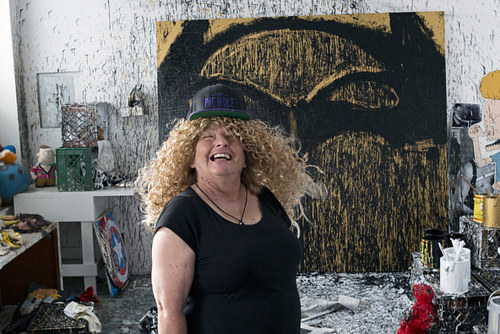 A photo of Joyce Pensato working in her Brooklyn studio