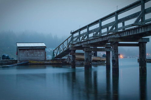 photo of a ramp over water in the fog