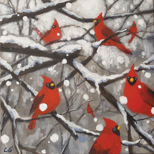 An art print of a painting of several cardinals perched on a snowy branch