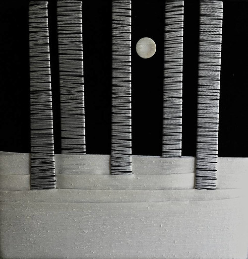 A textile art  piece depicting snowy birch trees under moonlight