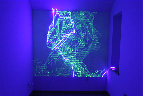 A laser projection on a phosphorescent wall