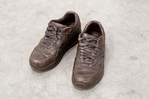 A bronzed pair of old sneakers
