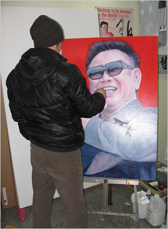 A photo of artist Sun Mu working on a painting