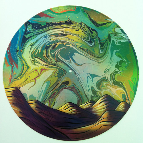 A painting of a desert scene of a vinyl record