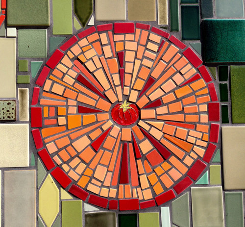 A close-up of a large mosaic, with an image of a tomato