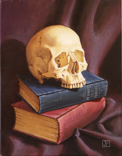 Still life of a skull on top of two books