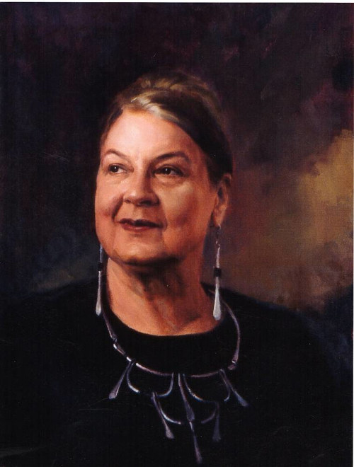 A distinguished looking oil painting of an older woman