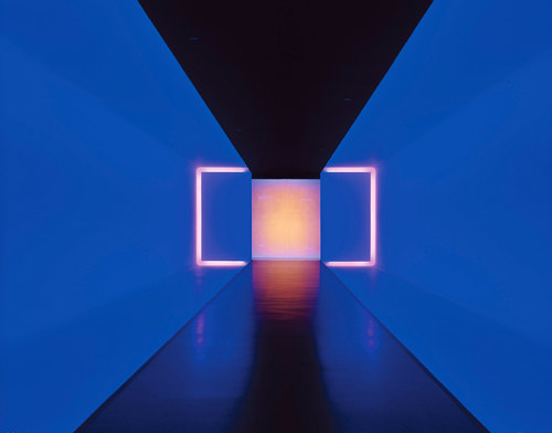 An installation work featuring a long blue light tunnel