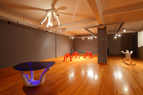 An installation view of several pieces of furniture with the human body as their structural basis