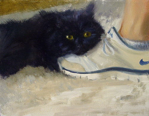 Painting of a black cat on a white shoe