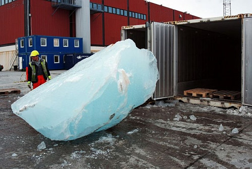 A chunk of ice being loaded into a shipping crate for Olafur Eliasson's Ice Watch