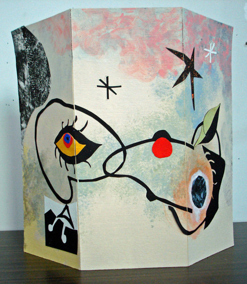 A painted and collaged screen made from board