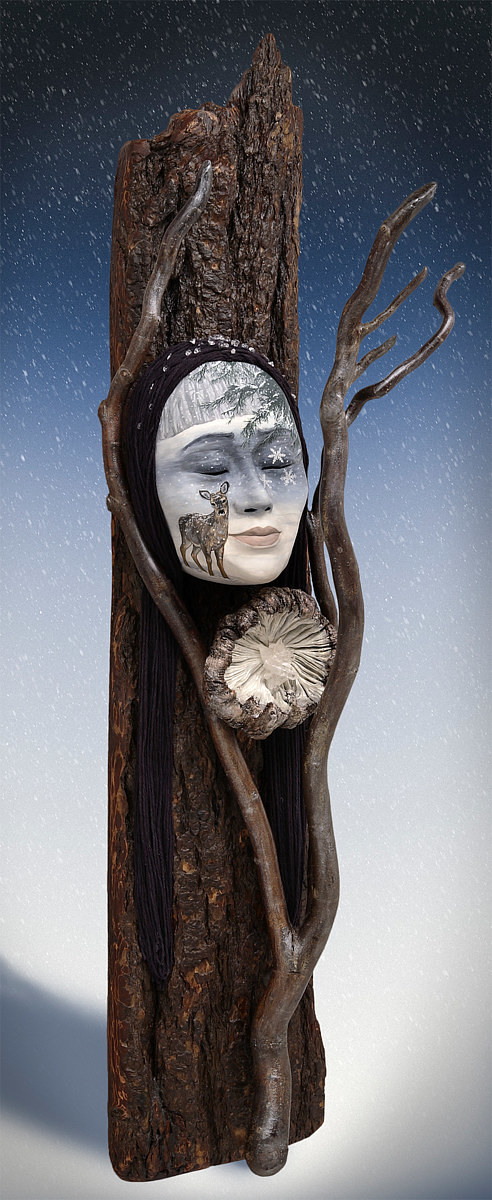 A canvas print of a painted mask mounted on a carved piece of wood