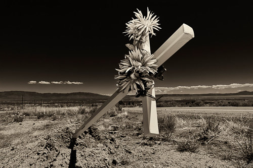 A photo of a toppled roadside memorial in New Mexico