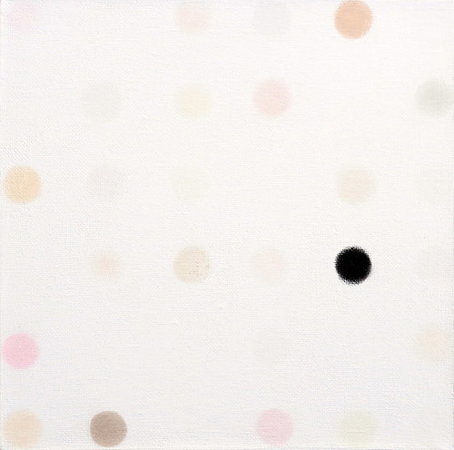 An artwork featuring circles of pastel on a white canvas