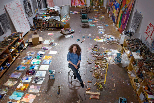 A photo of painter Dana Schutz working in her studio