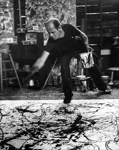 A photo of Jackson Pollock working in his studio