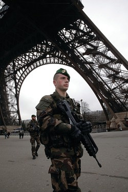 A soldier guarding the Eiffel tower in France