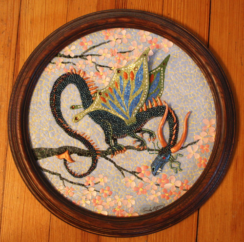 A mixed-media mosaic artwork depicting a small dragon in a cherry tree