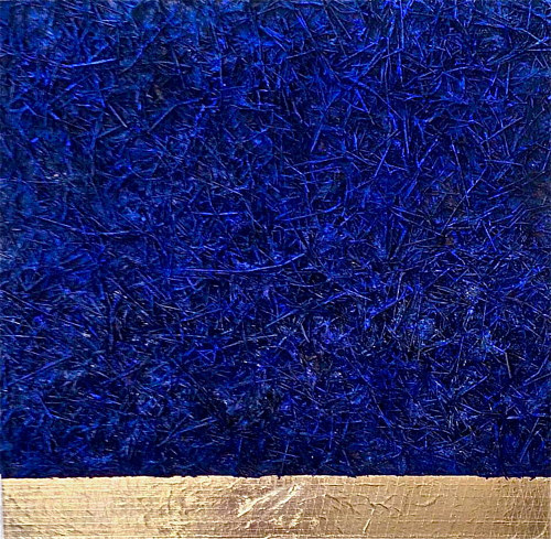 A mixed media artwork with texture built up from blue-coloured hay