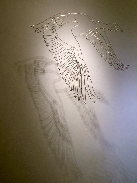 An installation view of a wire-sculpted goose