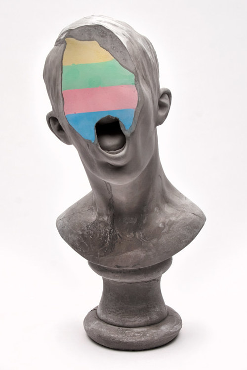 A bust of a male figure with the face partially obscured by colour