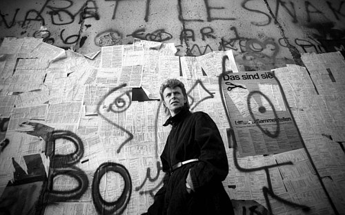 A photo of David Bowie in front of the Berlin Wall by Denis O'Regan for Getty Images