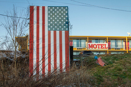 A photo of an American flag sign in front of a motel in Kentucky