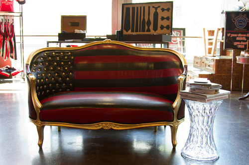 A photo of a loveseat upholstered with the American flag