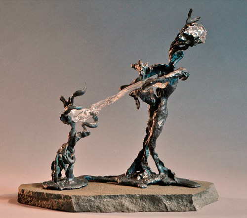 A sculpture of two abstracted forms in an apparent tug-of-war