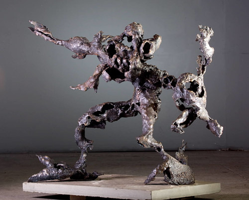A sculpture of abstracted figures caught in fluid movement