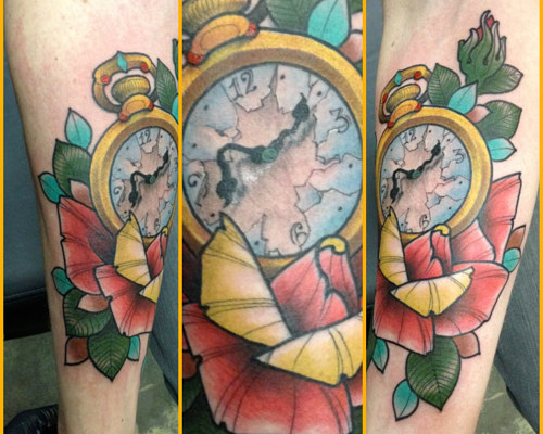 A tattoo of a clock placed among several flowers
