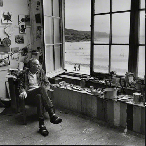 A photo of Terry Frost sitting in his art studio
