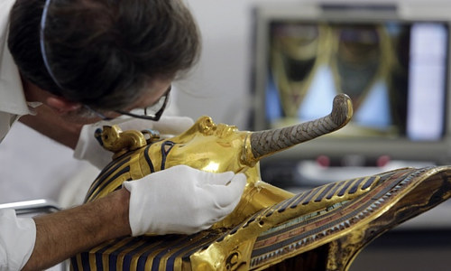 A photo of the restoration efforts on King Tut's beard