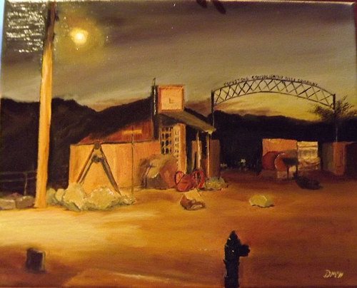A painting of a mine in Arizona at dusk