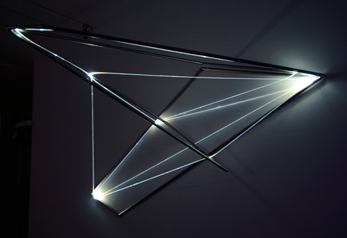 A sculpture of fiber optics and structural elements