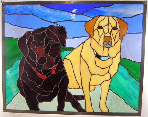 A stained glass panel depicting two dogs