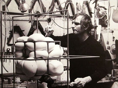 A photo of Piotr Kowalski working on a sculpture in his studio