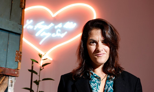 A photo of Tracy Emin in front of a new work