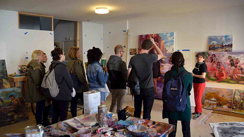 A photo of a group of people visiting Angela Dufresne's studio