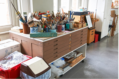 A photo of painting supplies in Allen Jones' studio
